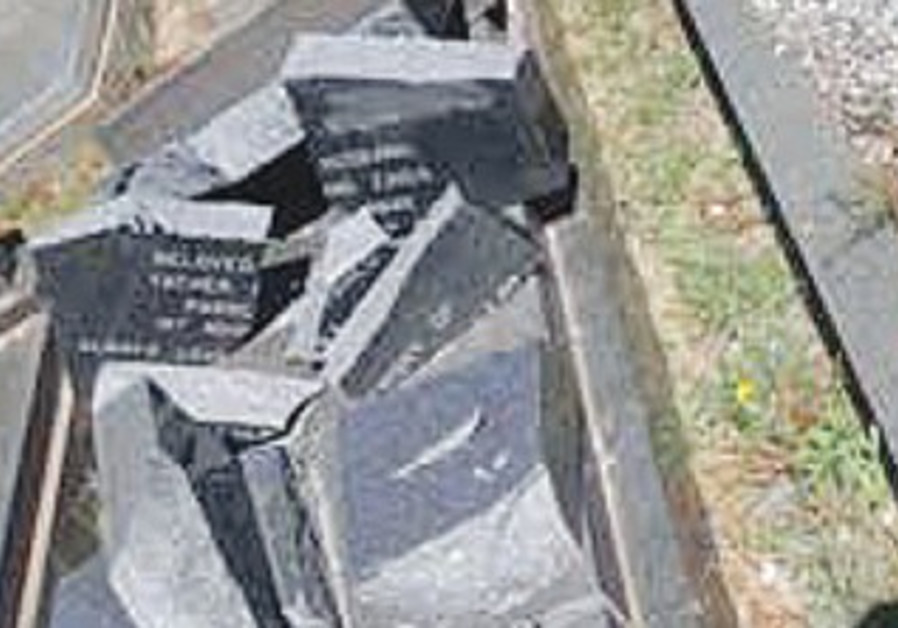 JEWISH GRAVESTONES in South Africa are seen shattered after vandals attacked the site.