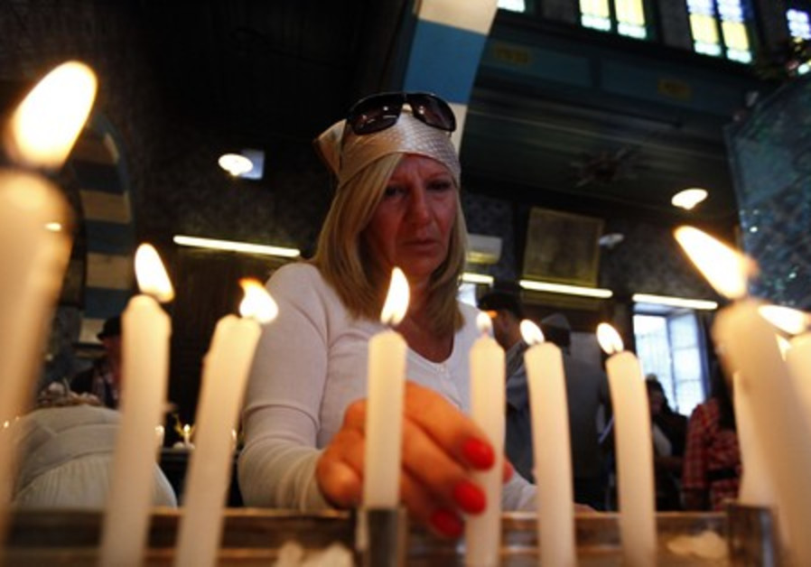 Candle lighting in Ghriba synagogue in Tunisia