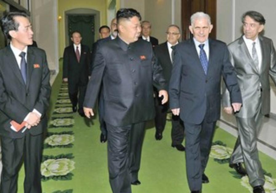 NORTH KOREAN leader Kim Jong-Un walks with Syria's Abdullah al-Ahmar.