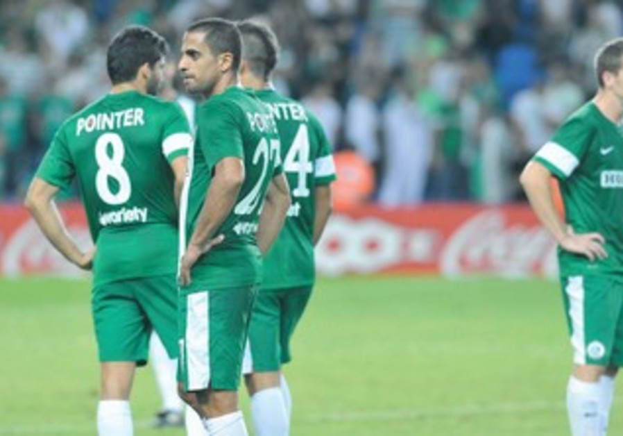 MACCABI HAIFA players (Eyal Meshumar, center) didn't know where to hide after losing 1-0
