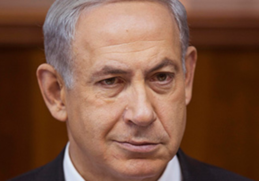 Binyamin Netanyahu attends the weekly cabinet meeting in Jerusalem, November 3, 2013.