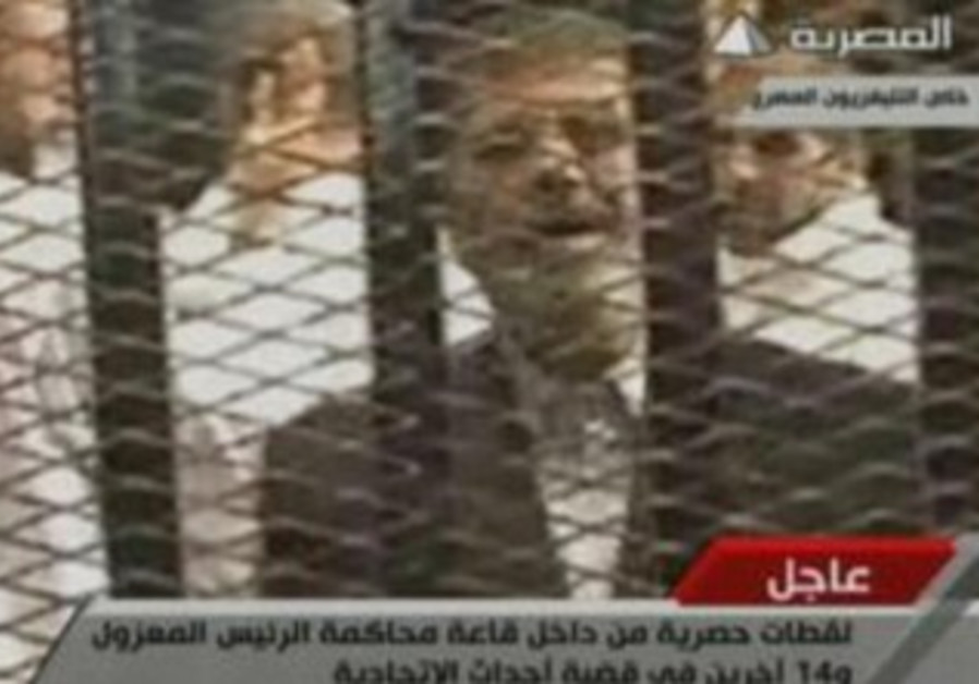 Ousted Egyptian president Mohammed Morsi in first day of his trial, November 4, 2013.
