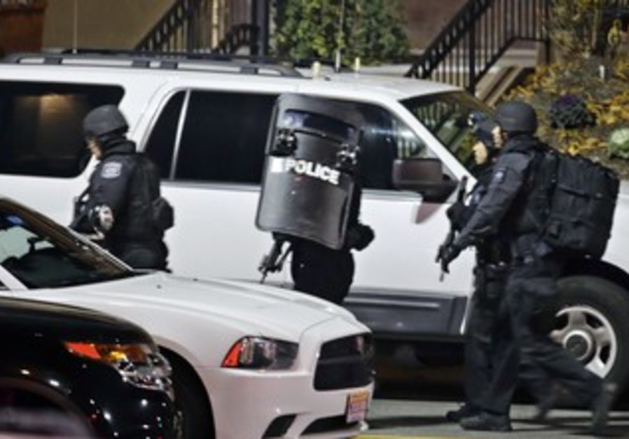 Police prepare to search New Jersey mall after shooting, Nov. 5, 2013.