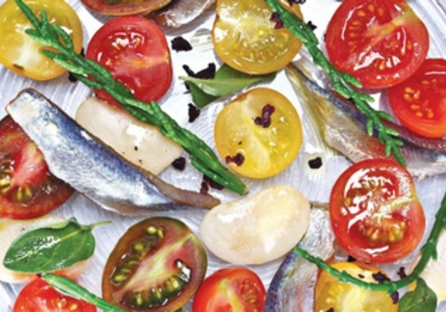 Fresh anchovies and cherry tomatoes