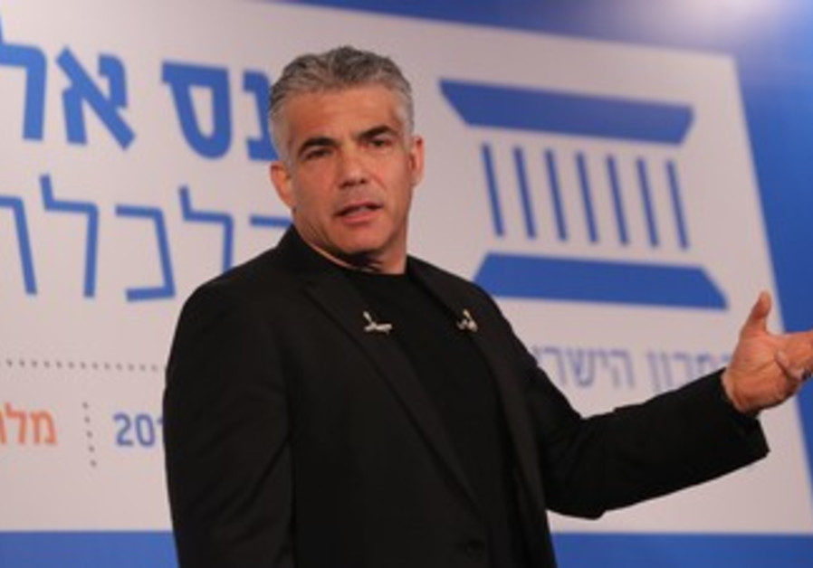 Finance Minister Yair Lapid at the IDI's Eli Hurvitz conference on economy and society.