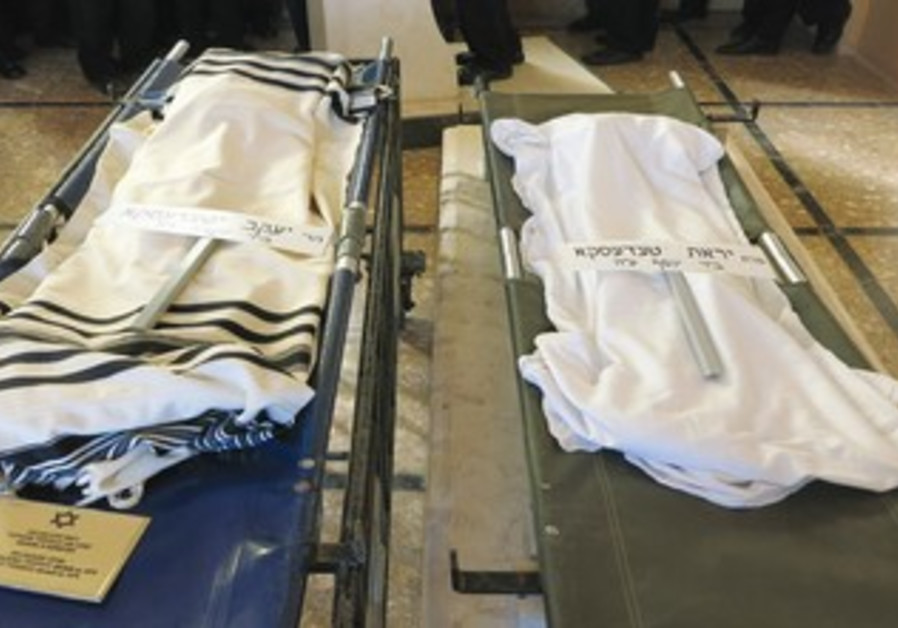 Exhumd remains brought to Israel