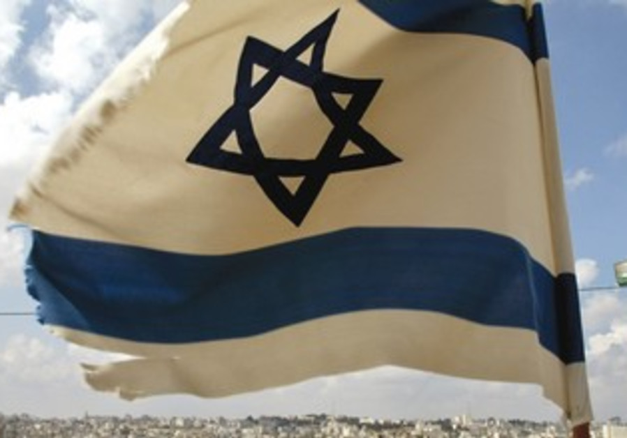 AN ISRAELI flag flutters near Psagot in the West Bank.