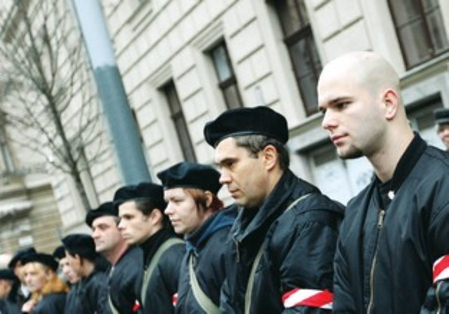 MEMBERS OF the Hungarian Guard, a far right nationalist group at a rally.