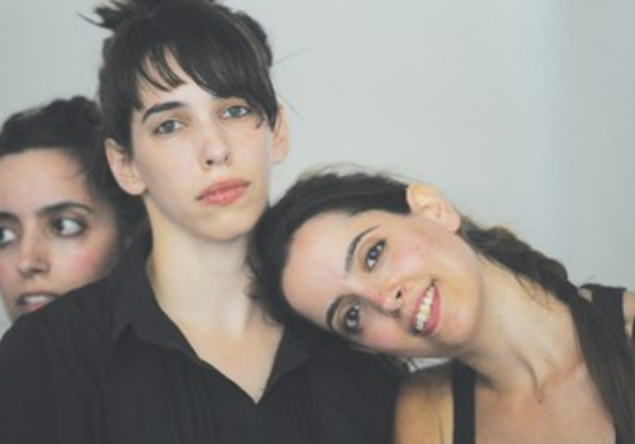 Adi Weinberg (center) with twin sisters Michal and Noa Gimelshtein in the dance piece 'Relative.'