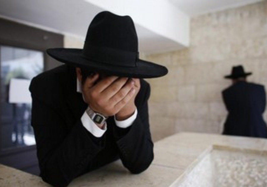 Ultra-orthodox man crying [illustrative].