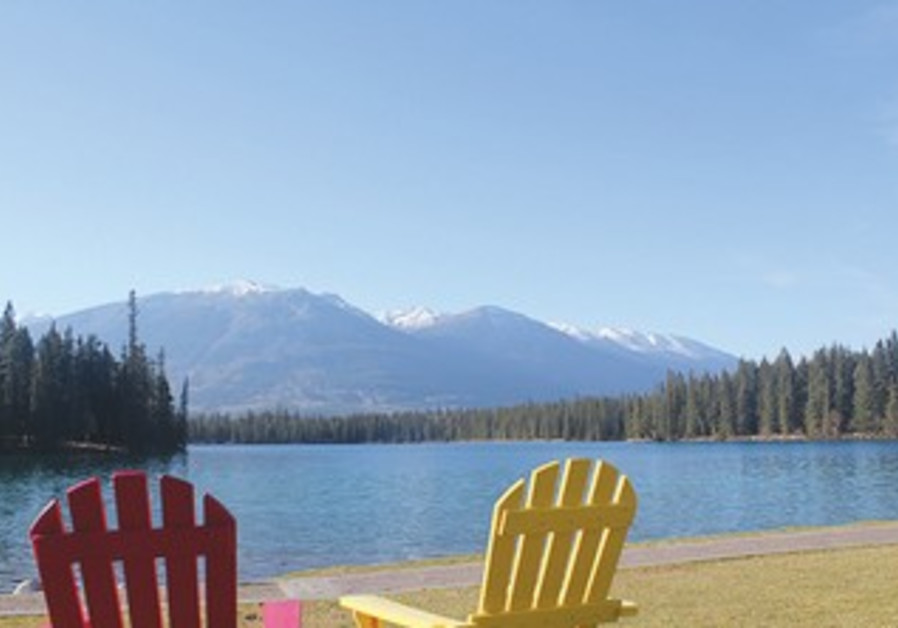 LODGING AT THE Fairmont Jasper Park Lodge affords a view of Beauvert Lake.