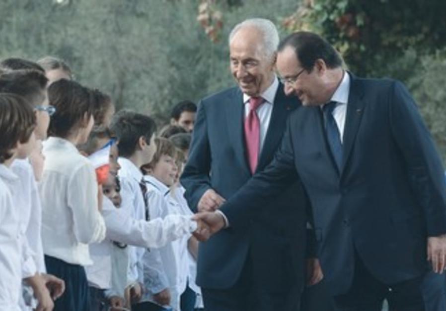 François Hollande shakes hands with members of a children's chorus, Nov. 17, 2013