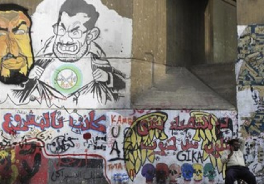 Graffiti denouncing ousted Egyptian President Mohamed Morsi  near Tahrir Square in Cairo.
