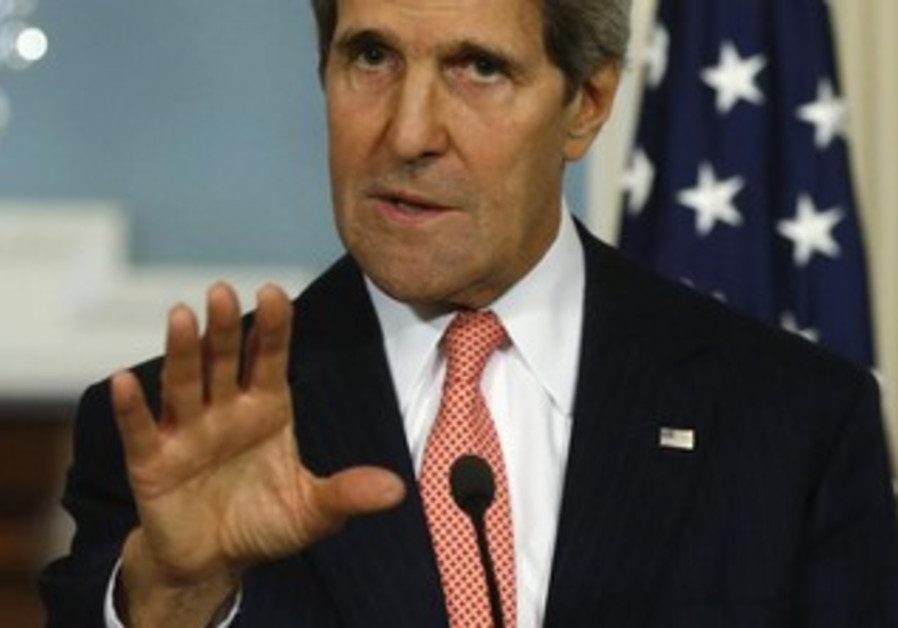 US Secretary of State John Kerry speaks to reporters with Turkish Foreign Minister Ahmet Davutoglu.