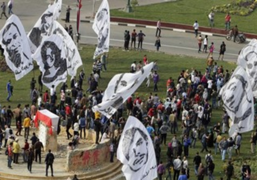 Protesters wave banners with pictures of  people who died in previous Egyptian revolutions, Nov 19.