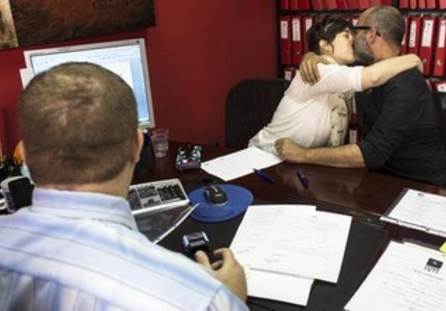 An Israeli couple signs an unofficial marriage agreement