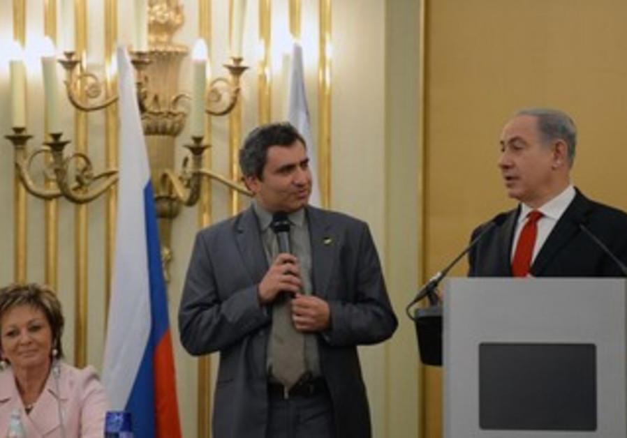 Deputy FM Ze'ev Elkin and Prime Minister Binyamin Netanyahu in Russia.