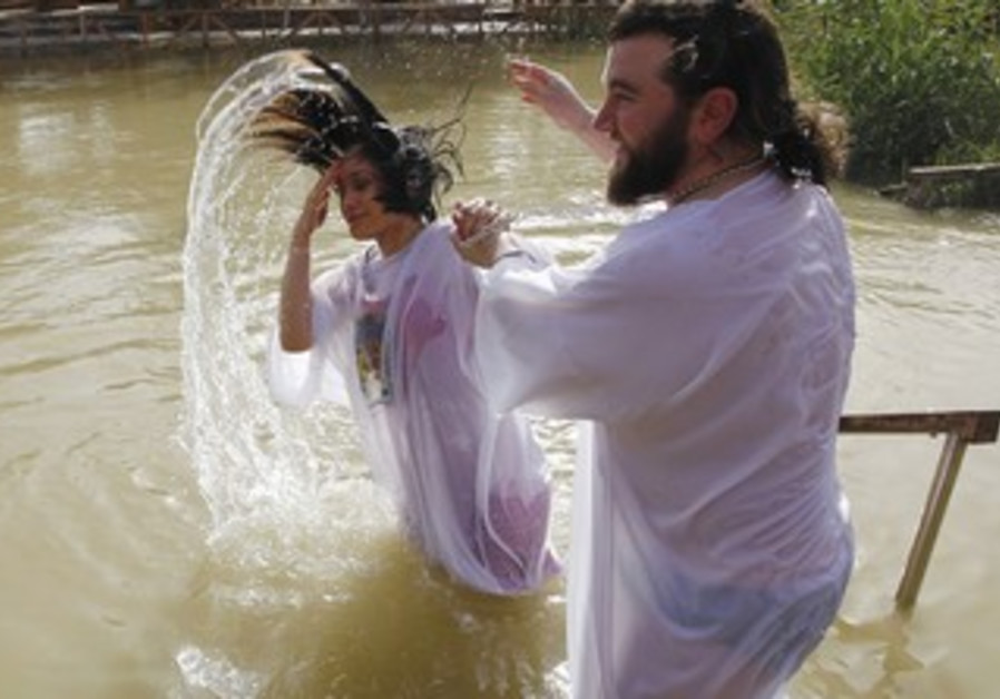 A CHRISTIAN pilgrim emerges from the water during a baptism ceremony in the Jordan River.