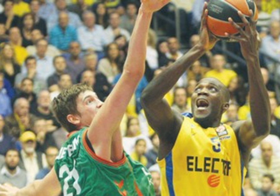 Mac TA's Shawn James shoots over Laboral's Tibor Pleiss