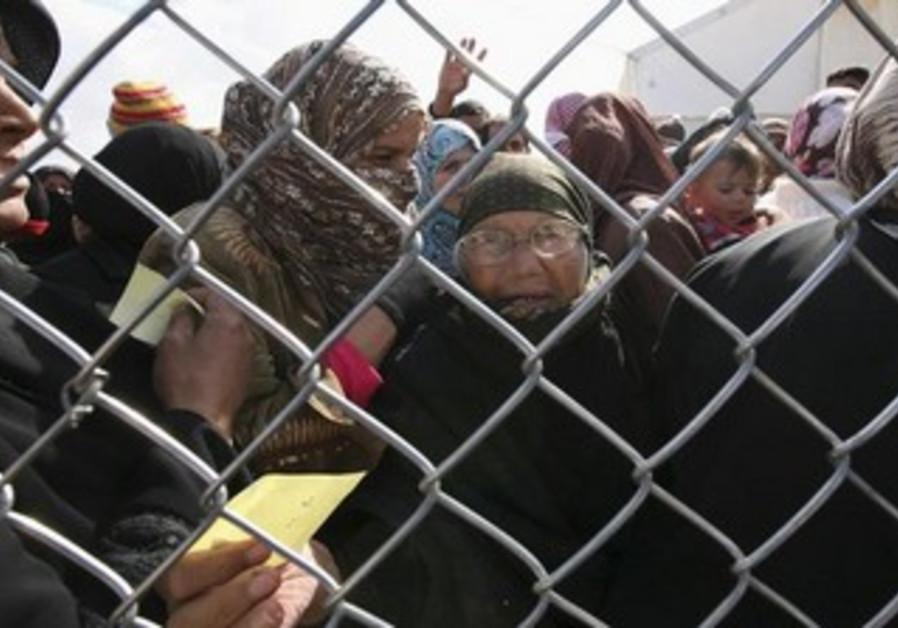 Syrian refugees [Illustrative].