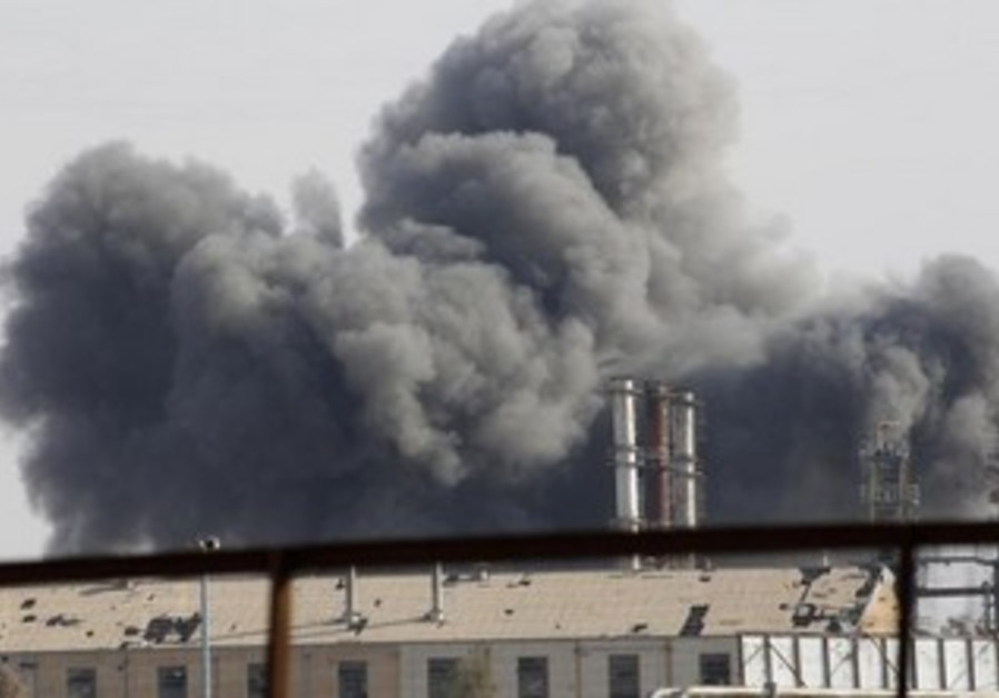 Smoke rises due to clashes in the Syrian town of Raqqa