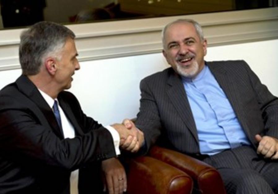 Iranian FM Zarif with Swiss counterpart Burkhalter at Geneva nuclear talks, Nov 23, 2013