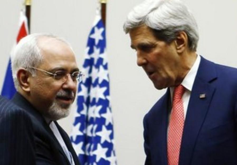 US Secretary of State Kerry shakes the hand of Iranian counterpart Zarif in Geneva, Nov 24, 2013.