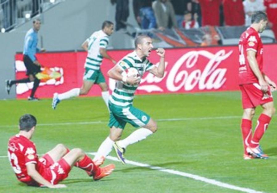 Shimon Abu Hazeira celebrates after his penalty-shot goal in Maccabi Haifa's 4-2 win at Hapoel TA.