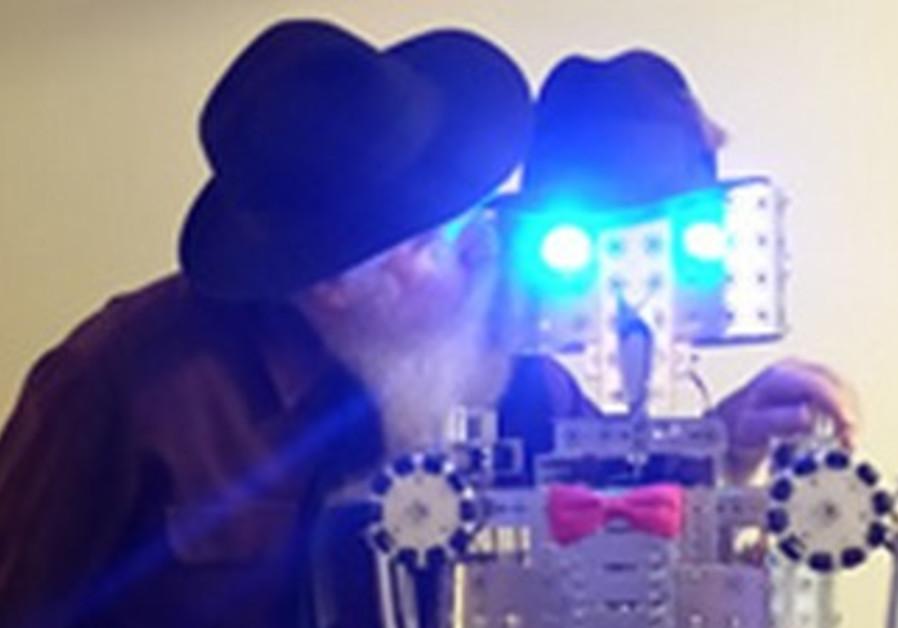The 'Isaac' robot will light a 22-foot-high 'Mama Menorah' in San Francisco Tuesday.