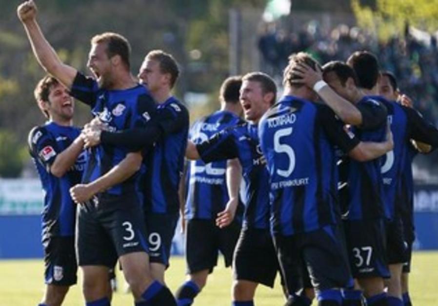 Frankfurt FSV players celebrate after goal.