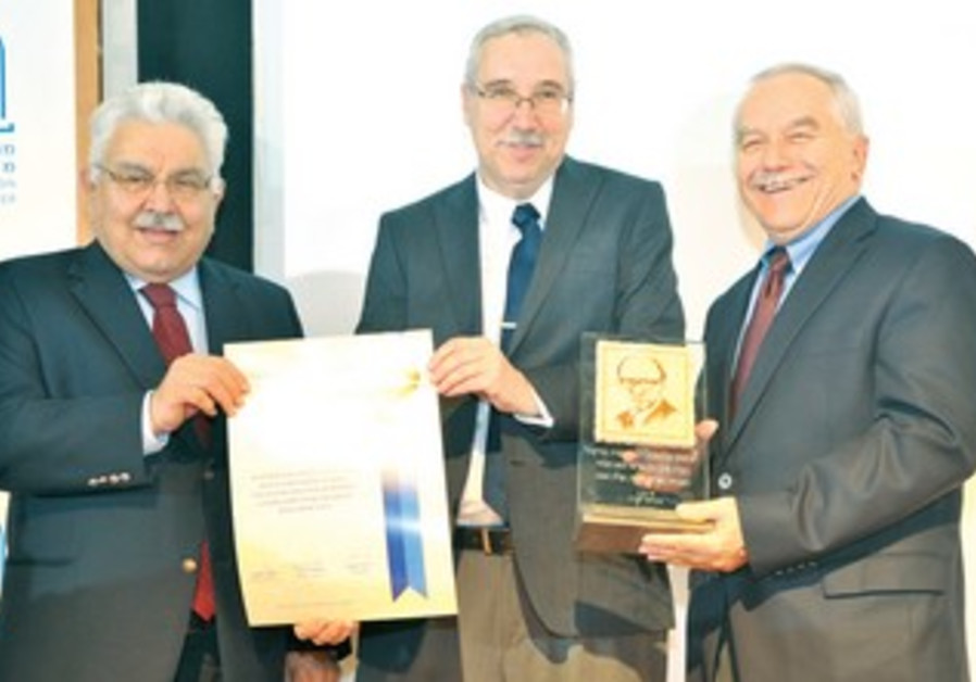 NGO Moniter president Prof. Gerald Steinberg, flanked by Begin Prize Committee chairman Moshe Nissim