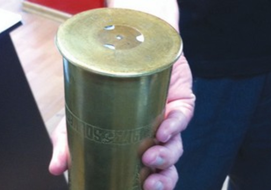 The writer holding the shell casing.
