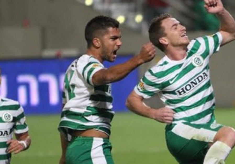 Maccabi Haifa players celebrate.