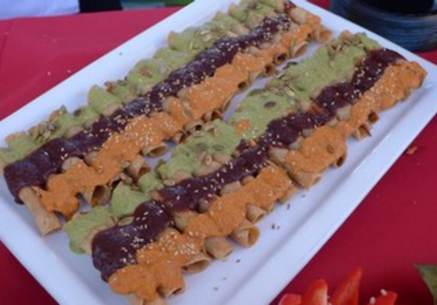 At the festival, a striking display of tacos coated with three different sauces caught the attention