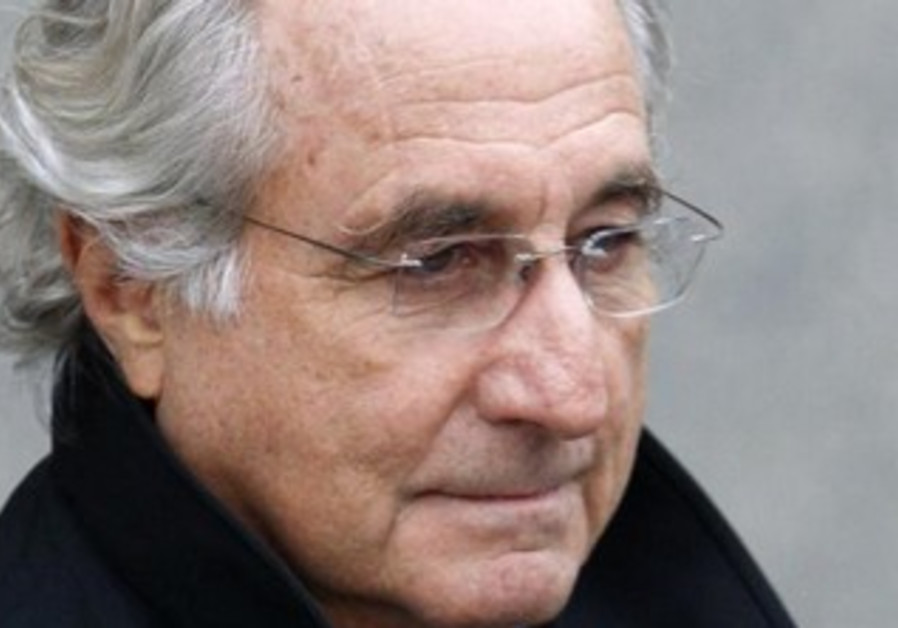 Bernard Madoff exits the Manhattan federal court house in New York, January 14, 2009
