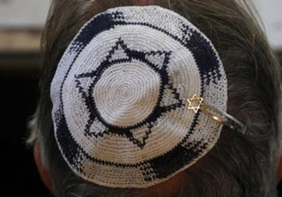 Head shown with Israeli flag design kippa