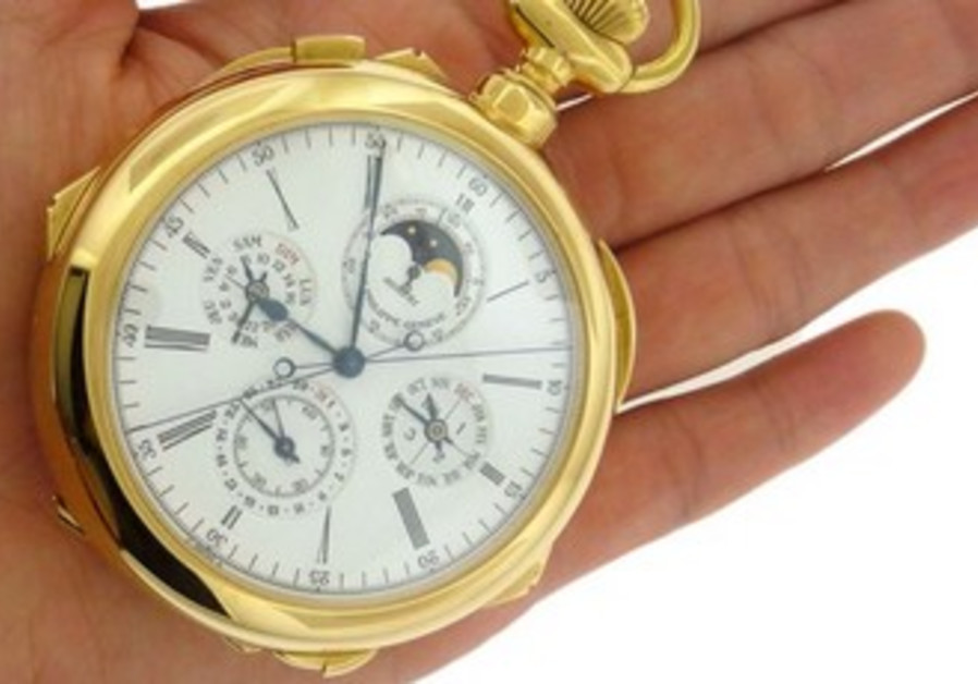 Golden watch auctioned on eBay.