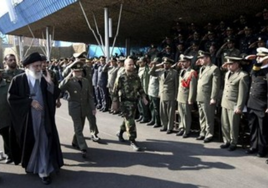 Iran's Supreme Leader Ayatollah Ali Khamenei (2nd L) waves to Iran's army commanders.