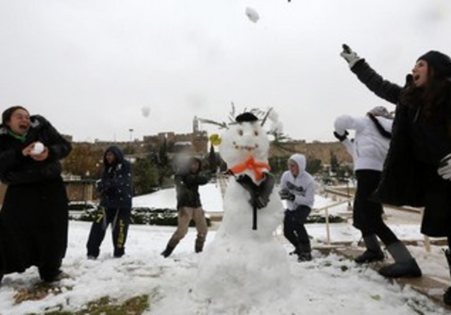 Girls have a snowball fight in Jerusalem, December 12, 2013.