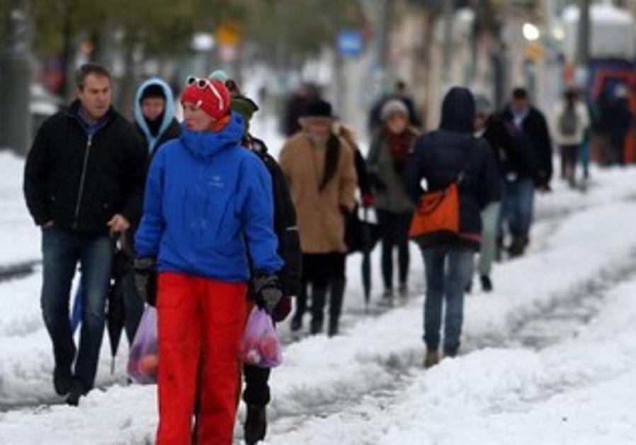 People in Jerusalem walking in snow, December 13, 2013