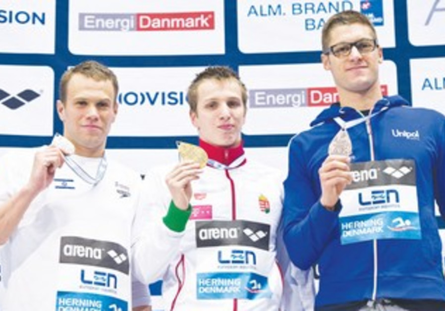 ISRAEL'S GAL NEVO (left) holds the silver medal he won at the European Short Course Championships