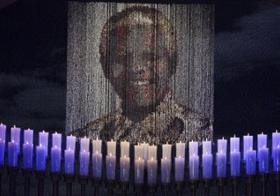 Candles lit at Nelson Mandela's funeral ceremony in Qunu, South Africa, December 15, 2013.