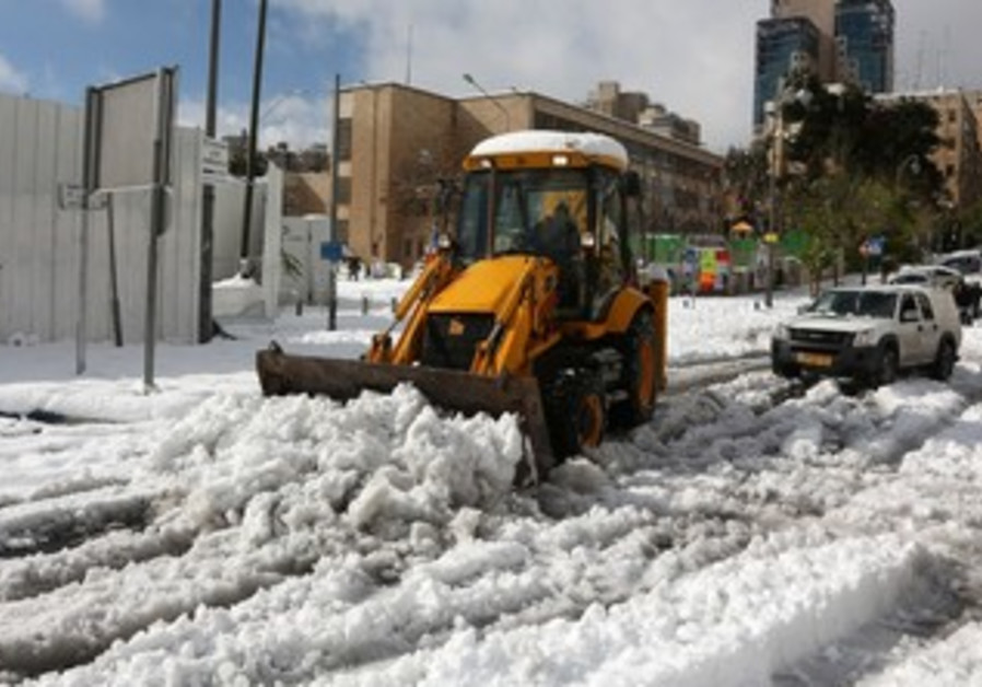 A tractor clearing a road from snow in Jerusalem, December 2013.