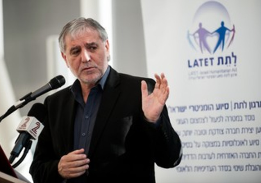 Welfare Minister Meir Cohen speaks at the National Conference of Charities.