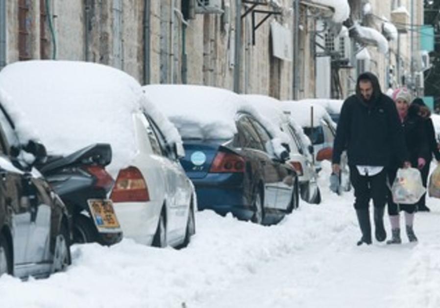 Pedestrians in the snow in Jerusalem.