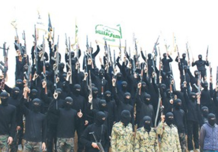 Syrian Islamist fighters at graduation ceremony at a camp in eastern al-Ghouta.