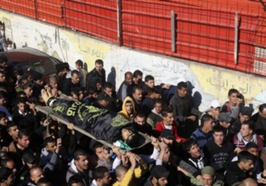 Palestinians carry the body of Nafeh al-Saadi before his funeral in the West Bank city of Jenin
