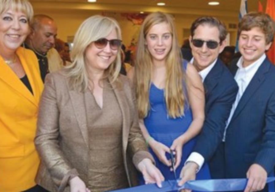 (Netanya mayor Miriam Fierberg-Ikarleft), with Lisa and Richard Baker and their children.