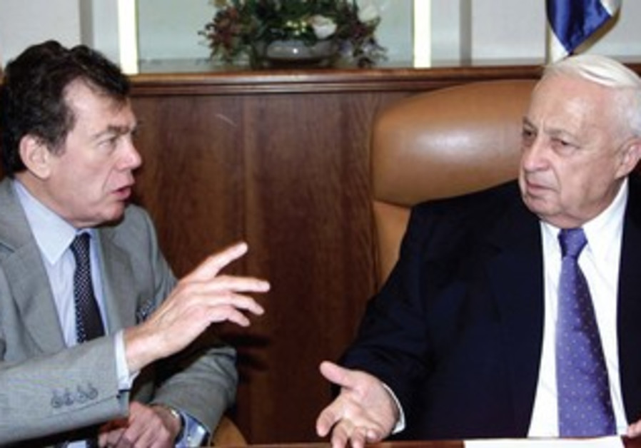 Then-PM Ariel Sharon chats with Edgar Bronfman in Jerusalem in October 2002.