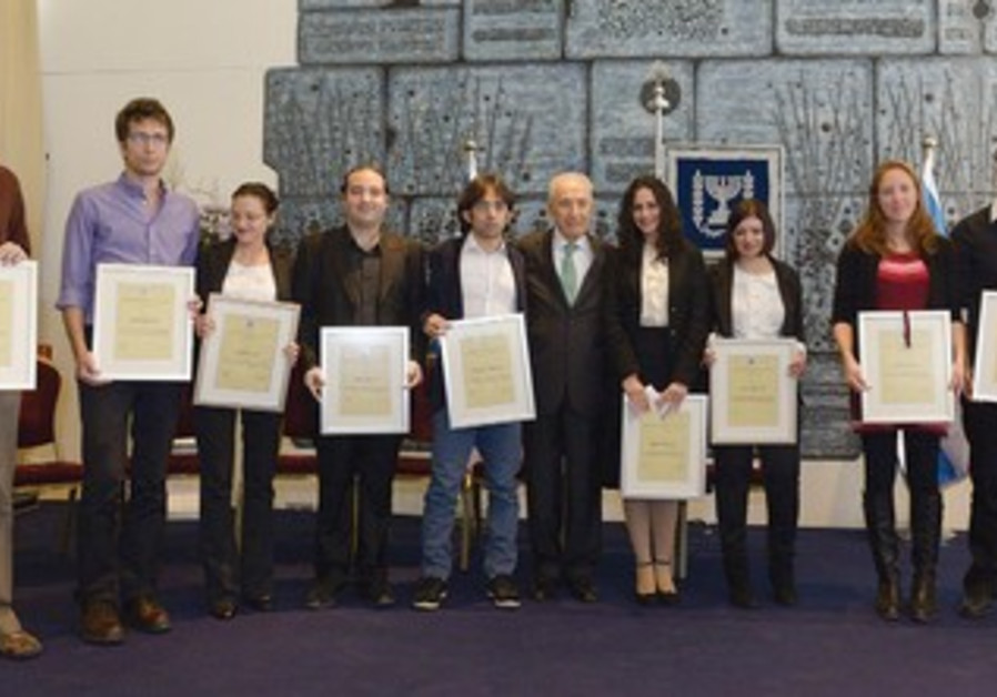 THE TOP 10 brain researchers hold their scholarship certificates, presented to them by Peres